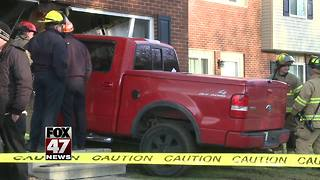 Truck crashes into Lansing area home