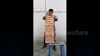 Chinese Soldier Breaks 14 Bricks Using His Hand - Video