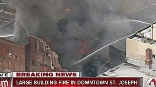 Crews work to put out building fire in St. Joseph - Video