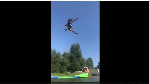 Kid goes soaring into air from inflatable water catapult
