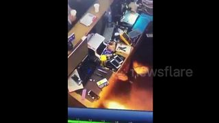 Fire shoots out of smart phone during repair - Video