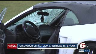 Greenwood officer struck by vehicle while directing traffic - Video