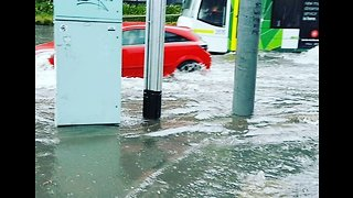 Vehicles Travel Along Flooded Road After Torrential Storm in Melbourne - Video