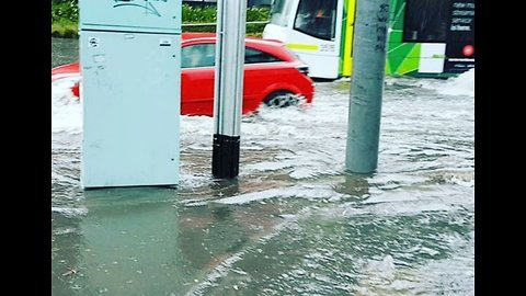 Vehicles Travel Along Flooded Road After Torrential Storm in Melbourne