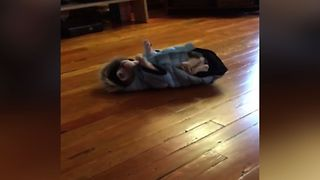 Clumsy Puppy Can't Handle New Coat - Video
