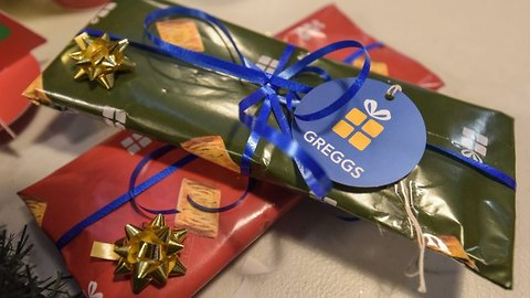 Deck the rolls: Greggs elves offer free festive steak bake wrapping to frazzled shoppers – and you can even buy sausage roll socks