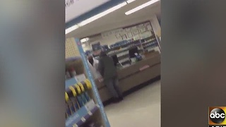 Man asks for painkillers in pharmacy robbery - Video