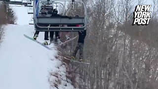 Boy dangling from ski lift narrowly escapes injury