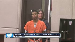 Man charged in woman's brass knuckles beating, attempted carjacking - Video