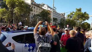 Protesters Block Police Car as Catalan Official Arrested During Raid - Video