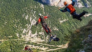 Feeling jumpy – Nervous base jumper sees friends go racing past him  - Video