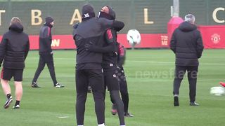 Ashley Young hit on back during United training - Video