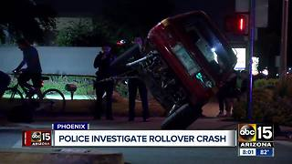 Police investigating rollover crash in Phoenix - Video
