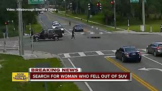 VIDEO: Woman appears to fall out of moving Ford Expedition in Tampa intersection near USF - Video