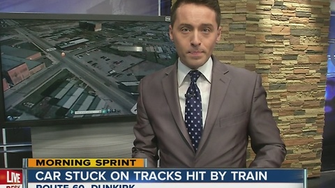 Snow causes driver to get stuck on train tracks, hit by train