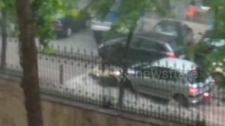 Garbage can strikes cars in sudden Greece rainstorm - Video