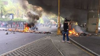 Protesters Block Caracas Roads With Debris Fires - Video