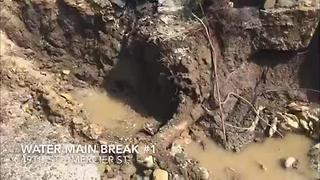 Water main break floods street near Plaza - Video
