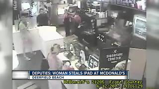 Woman Steals IPad at McDonald's - Video