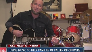 Indiana man using song to help families of fallen officers - Video