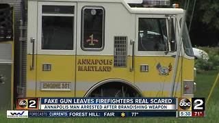 Fake gun leaves firefighters real scared - Video