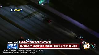 Burglary suspect surrenders after chase - Video