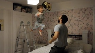 Dad Keeps Son Entertained With Amusing Wrestling Antics - Video