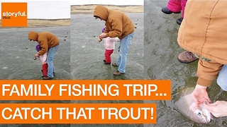 Family Catch Rainbow Trout During Ice Fishing Trip - Video