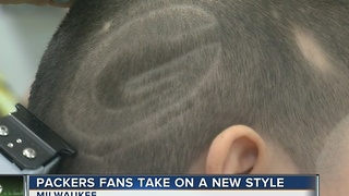 Milwaukee barber gives out unique Packers cuts - Video