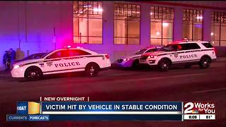Person recovering after being hit by a vehicle in downtown