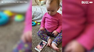 Baby gets emotional after seeing video of herself with dad
