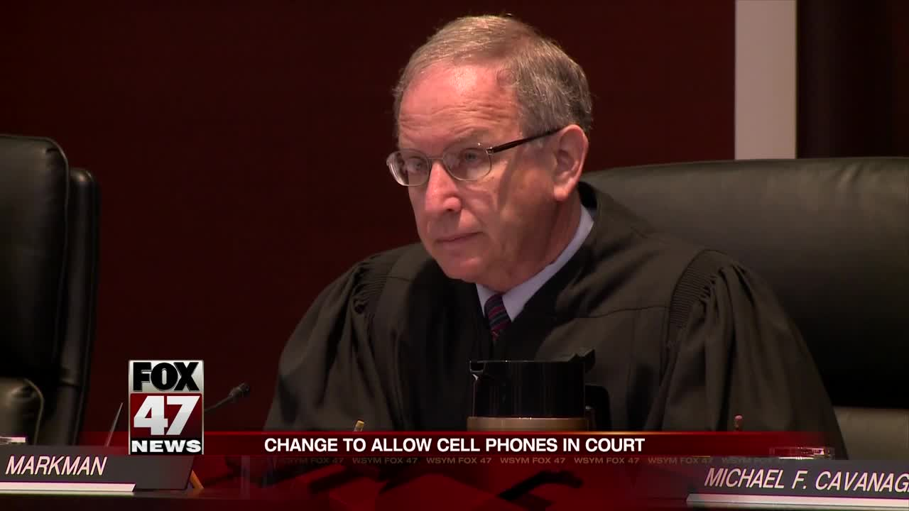 Change to allow cell phones in court