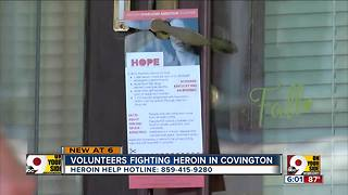 Volunteers go door to door distributing Northern Kentucky Addiction Helpline pamphlets - Video