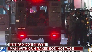 Man with a gun takes son hostage - Video