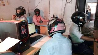 Bizarre:Employees wear helmets insidegovt office to save their head from falling parts of roof - Video