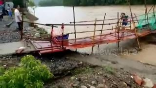 Foot bridge collapses moments after woman crosses it - Video