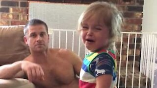Dad stops daughter crying with foolproof trick!