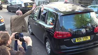Jeremy Corbyn misses another high-five as he leaves his house in London - Video
