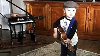 Adorable little boy loves country music