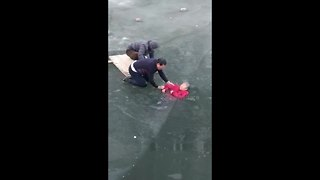 Brave Man Rescues Elderly Woman Trapped In Icy River - Video