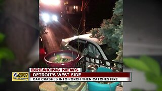 Car crashes into porch then catches fire