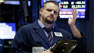 Wall St. opens lower as U.S.-China trade talks resume