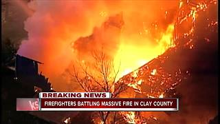 Crews battle massive house fire in rural Clay County - Video