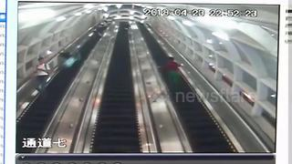 Runaway suitcase caught on video knocking down woman on escalator - Video