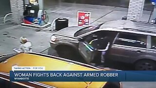 Woman fights back against armed robber