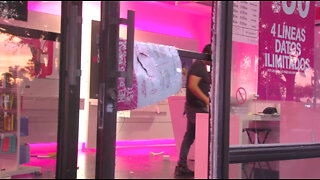 'It hurts,' T-Mobile store owner says after looters ransack business