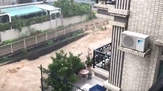 Torrent of Floodwater Courses Through Hong Kong's Northeastern Tai Po District - Video