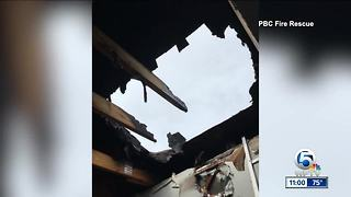 Jupiter apartment catches fire due to possible lightning strike - Video
