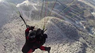 Daredevils speed fly over a winter wonderland! - Video