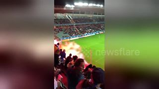 Bosnia soccer fans throw flares onto pitch - Video
